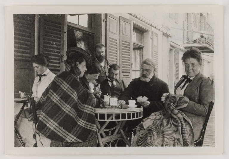 Image of Joseph Joachim playing cards outside a coffee shop