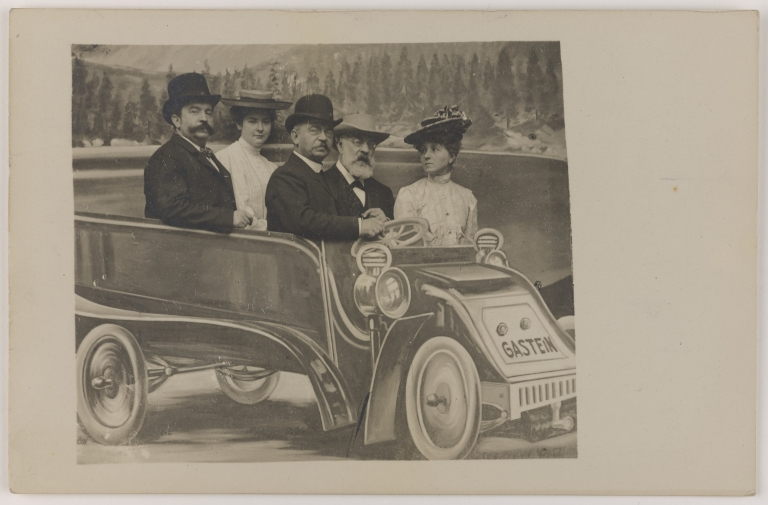 Postcard of Joseph Joachim in a fake car with the Mendelssohn brothers