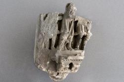 Gandharan sculpture fragments: Female figure in draped robe