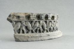 Gandharan sculpture fragments: Satyrs with garlands